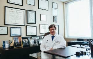 hand surgeons sitting at a desk